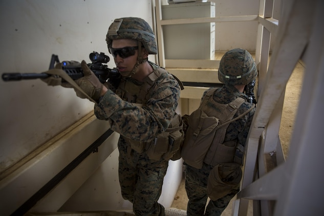MARINE CORPS BASE HAWAII – Marines from Alpha Company, 1st Battalion, 3rd Marine Regiment, practice clearing buildings during Exercise Island Viper aboard Marine Corps Base Hawaii, Sept. 28, 2016. Marines wrap up their final week of Exercise Island Viper, an annual pre-deployment training event preparing Marines for a larger exercise in the Pacific Region. During Exercise Island Viper, the Marines practiced clearing buildings, patrolling through simulated villages, solved obstacles at the Leadership Reaction Course and traversing through an Improvising Explosive Devices course. (U.S. Marine Corps Photo by Lance Cpl. Jesus Sepulveda Torres)