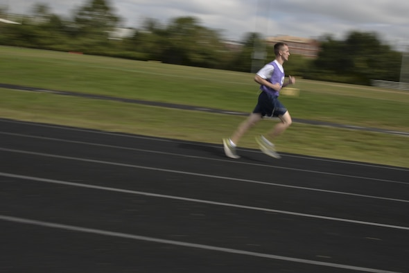 Airman 1st Class Michael, 94th Intelligence Squadron, runs during his fitness assessment test October 7, 2016 at Fort George G. Meade, Md. In the recent identification of installation 1.5 mile-run and 2.0-kilometer course-length issues, recertification actions have begun across the Air Force. To ensure Airmen receive accurate fitness assessments in the future, bases have been tasked to report all findings by Oct. 31, 2016. (U.S. Air Force photo/Staff Sgt. Alexandre Montes)