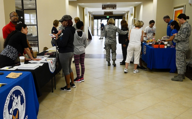 Members of the 6th Force Support Squadron and the United Services Organizations provide assistance to Hurricane Matthew evacuees Oct. 7, 2016, at MacDill Air Force Base, Fla. More than 150 evacuees traveled through MacDill's gates seeking refuge at the MacDill Inn. (U.S. Air Force photo by Senior Airman Jenay Randolph)