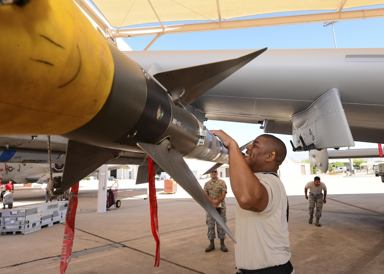 U.S. Air Force Staff Sgt. Leon Jones, 354th Aircraft Maintenance Unit weapons load crew chief, inspects an AIM-9 Sidewinder missile that was loaded onto an A-10C Thunderbolt II during a load crew of the quarter competition at Davis-Monthan Air Force Base, Ariz., Oct. 7, 2016. The load crews were evaluated based on timeliness and deficiencies during the contest. (U.S. Air Force photo by Airman Nathan H. Barbour)