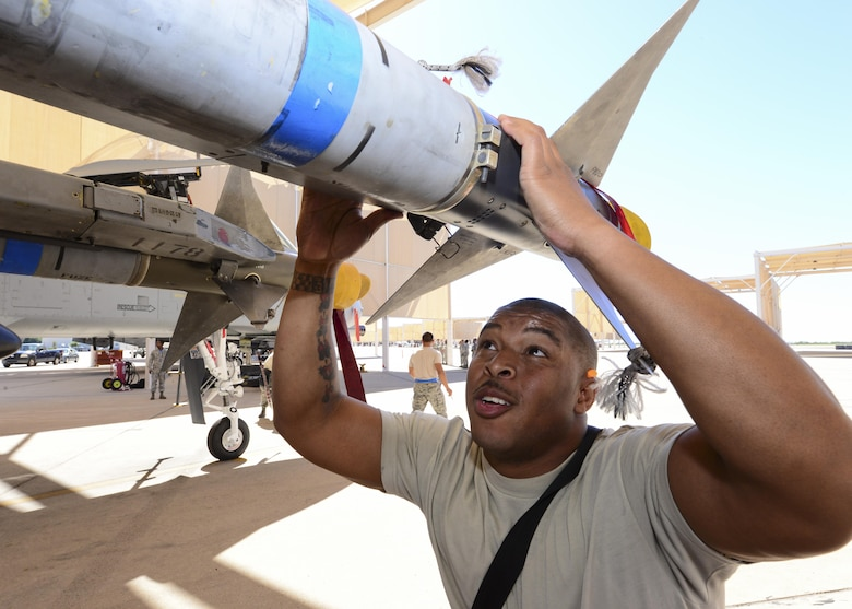 U.S. Air Force Staff Sgt. Leon Jones, 354th Aircraft Maintenance Unit weapons load crew chief, inspects an AIM-9 Sidewinder missile that was loaded onto an A-10C Thunderbolt II during a load crew of the quarter competition at Davis-Monthan Air Force Base, Ariz., Oct. 7, 2016. The objective of the competition is to determine which team can most efficiently load an A-10 with munitions with the least amount of deficiencies. (U.S. Air Force photo by Airman Nathan H. Barbour)