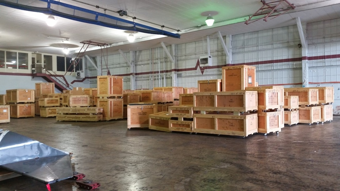 For Other Maintenance, or FOM, crates are shown stacked on the floor before installation of the ACTIVRAC 16 mobile high-density and permanent storage shelves. (Courtesy photo)