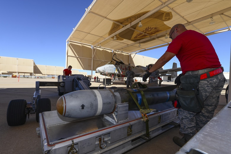 U.S. Airmen from the 355th Aircraft Maintenance Squadron check an AGM-65 Maverick missle for damage and serviceability during a weapons load crew competition at Davis-Monthan Air Force Base, Ariz., Oct. 7, 2016. This quarter's competition was between the 354th, 357th and 924th aircraft maintenance units. (U.S. Air Force photo by Senior Airman Chris Drzazgowski)