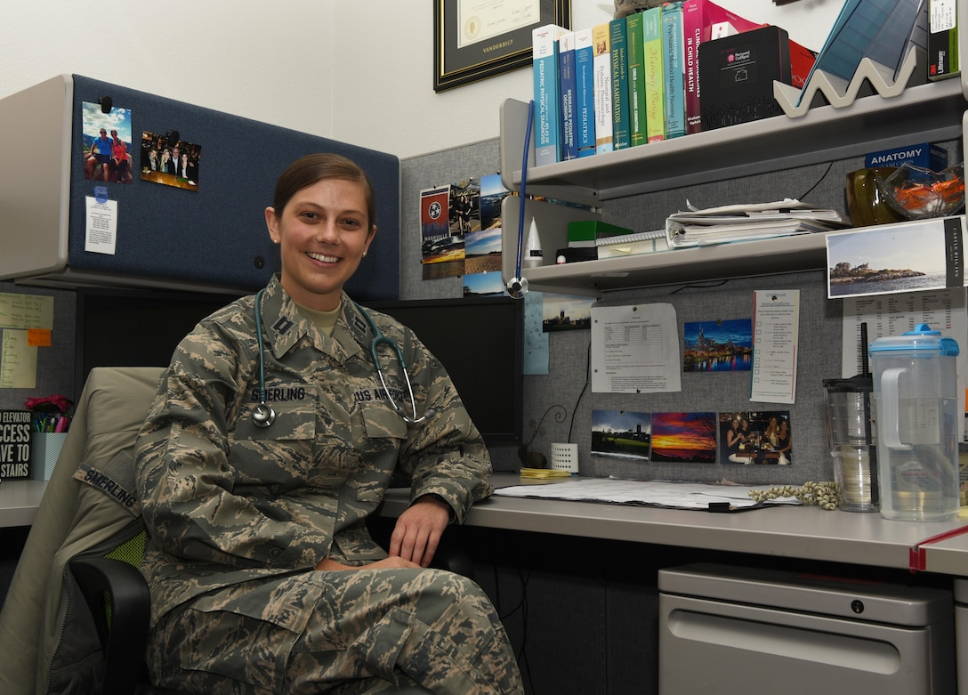 Capt. Kelly Smerling, 90th Medical Operations Squadron pediatric nurse practitioner, sits at her desk at F.E. Warren Air Force Base, Wyo., Sept. 29, 2016. Pediatrics is one of many sections in the 90th MOS that provides medical care. (U.S. Air Force photo by Airman 1st Class Breanna Carter)