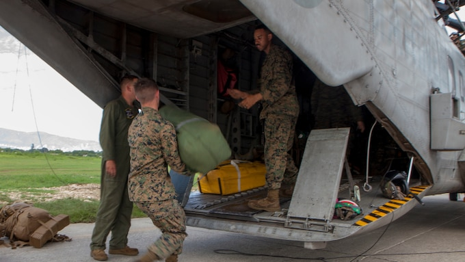 U.S. Marines with Special Purpose Marine Air-Ground Task Force – Southern Command and soldiers from Joint Task Force-Bravo's 1st Battalion, 228th Aviation Regiment arrive by CH-53E Super Stallion, CH-47 Chinook, and UH-60L Black Hawk helicopters at Port-au-Prince, Haiti, Oct. 6, 2016. These vertical take-off assets will prove critical in gaining access to areas that are otherwise unreachable due to Hurricane Matthew. The Marines and soldiers are a part of Joint Task Force Matthew, a U.S. Southern Command-directed team deployed to Port-au-Prince at the request of the Government of Haiti, on a mission to provide humanitarian and disaster relief assistance in the aftermath of Hurricane Matthew.