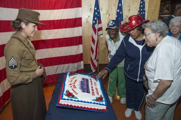 Members of the Women in the Air Force, the term for women who joined the Air Force between the years of 1949 -1976, view a celebratory cake with a photo of the first all-female Air Force basic Military Training Class during the Joint Base San Antonio WAF Reunion Oct. 7 at JBSA-Lackland. WAF was founded in 1948 out of the Women's Armed Service Integration Act, which enabled tens of thousands of female service members to find jobs in the Air Force. In 1976 women were accepted into the service on an equal basis with men.