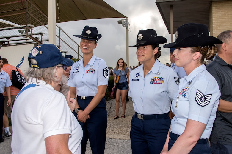 Military training instructors speak with female veterans, known as  Women in the Air Force, a term for women who joined the Air Force between 1949 and 1976, during the Air Force Basic Military Training graduation parade Oct. 7, 2016, at Joint Base San Antonio-Lackland's parade grounds. JBSA-Lackland hosted a reunion of the WAF members and provided the veterans a tour of the base. WAF was founded in 1948 out of the Women's Armed Service Integration Act, which enabled tens of thousands of female service members to find jobs in the Air Force. In 1976 women were accepted into the service on an equal basis with men.