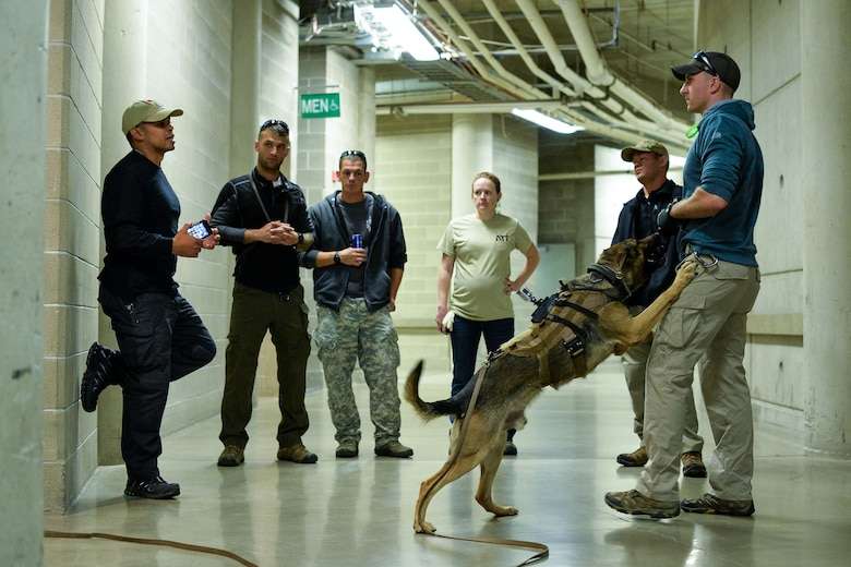 Bureau of Alcohol, Tobacco, Firearms and Explosives Special Agent Rennie Mora, left, talks with Staff Sgt. Joshua Rettschlag, 366th Security Forces Squadron, after completing homemade explosion detection testing Oct. 6 at Vivint Smart Home Arena, Salt Lake City. Airmen and their K-9 counterparts, along with dog teams from local, state and federal law enforcement agencies, received homemade explosives detection training from Bureau of Alcohol, Tobacco, Firearms and Explosives agents Oct. 5-6. (U.S. Air Force photo by R. Nial Bradshaw)