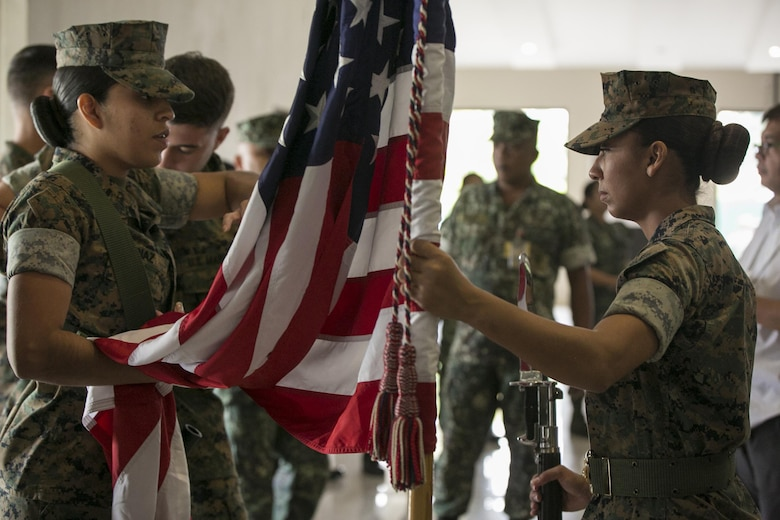 U.S. Marine color guard members, Sgt. Alexandra Diaz (left) and Pfc. Alejandra B. Ortega, prepare the U.S. flag before the Philippine Amphibious Landing Exercise 33 (PHIBLEX) opening ceremony at Marine Barracks Rudiardo Brown, Taguig City, Philippines, Oct. 4, 2016. PHIBLEX is an annual U.S.-Philippine military bilateral exercise which combines amphibious capabilties and live-fire training with humanitarian civic assistance efforts to strengthen interoperability and working relationships. Diaz, from Chicago, Ill., is a distribution management specialist with 3d Marine Expeditionary Brigade, III Marine Expeditionary Force. Ortega, from Orange, Calif., is an administrative clerk with 3d MEB. (U.S. Marine Corps photo by Cpl. Steven Tran/Released)