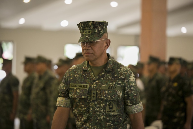 Philippine Marine Maj. Gen. Andre M. Costales Jr., commandant of the Philippine Marine Corps, marches to the stage of the Philippine Amphibious Landing Exercise 33 (PHIBLEX) opening ceremony at Marine Barracks Rudiardo Brown, Taguig City, Philippines, Oct. 4, 2016. PHIBLEX is an annual U.S.-Philippine military bilateral exercise which combines amphibious capabilities and live-fire training with humanitarian civic assistance efforts to strengthen interoperability and working relationships. (U.S. Marine Corps photo by Cpl. Steven Tran/Released)