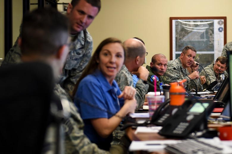 U.S. Air Force Col. Robert Lyman, Joint Base Charleston commander, discusses current and ongoing operations at the Emergency Operations Center during Hurricane Condition I for Hurricane Matthew on Joint Base Charleston, S.C., Oct. 7, 2016. All non-essential personnel evacuated the area, but will return after disaster response coordinators assess damage and verify a safe operating environment. (U.S. Air Force photo by Senior Airman Nicholas Byers)