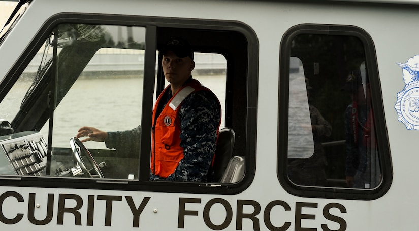 U.S. Navy Petty Officer 2nd Class William Roberts, a harbor patrol coxswain with the 628th Security Forces Squadron, prepares to move and store a 628th Security Forces patrol boat ahead of Hurricane Matthew at Joint Base Charleston - Naval Weapons Station, S.C., Oct. 7, 2016. All non-essential personnel evacuated the area but will return after disaster response coordinators assess damage and verify a safe operating environment.   (U.S. Air Force photo by Senior Airman Nicholas Byers)