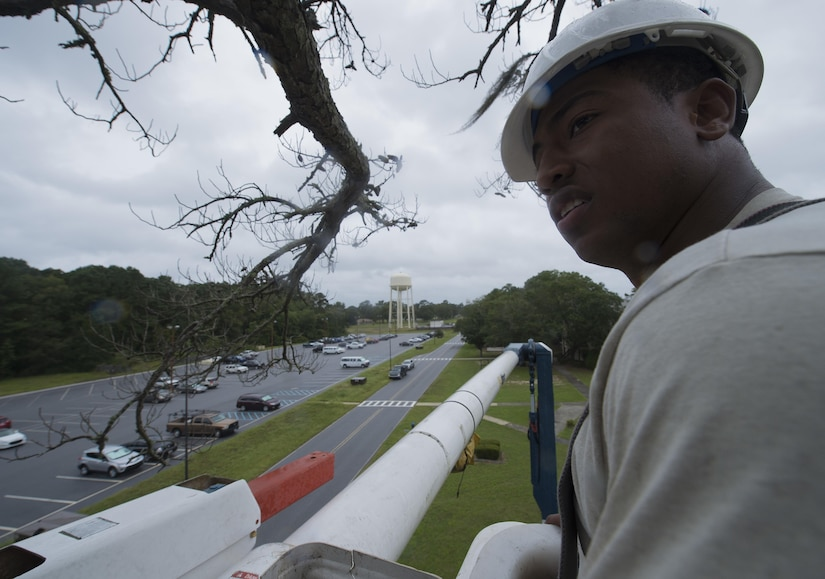 U.S. Air Force Senior Airman Jaylen Wilkins, an electrician assigned to the 628th Civil Engineer Squadron, prepares to fell a dead tree ahead of Hurricane Matthew at Joint Base Charleston, S.C., Oct. 7, 2016. All non-essential personnel evacuated the area, but will return after disaster response coordinators assess damage and verify a safe operating environment. (U.S. Air Force photo by Tech. Sgt. Barry Loo)