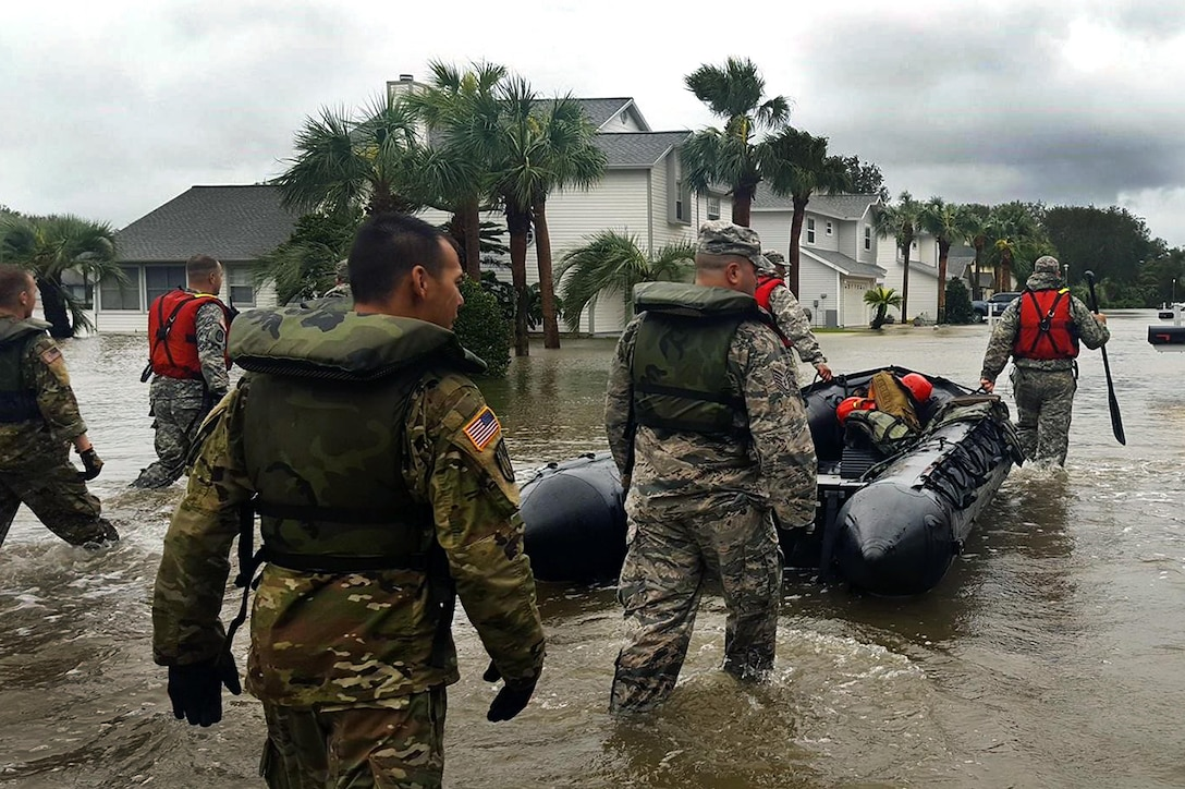 A search and rescue team with the Florida  National Guard wades into areas in St. Augustine, Florida, affected by Hurricane Matthew to assist with disaster relief efforts. More than 9000 Guard members are on duty throughout Florida, Georgia and the Carolinas assisting state and local authorities with search and rescue and relief operations.