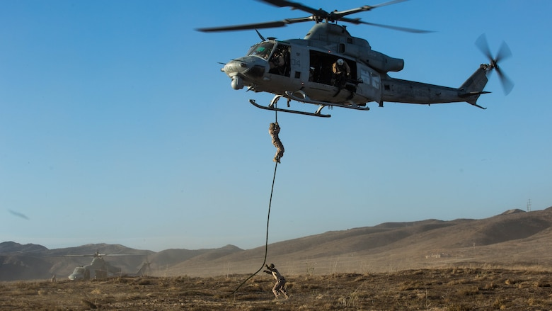 Marines with Marine Light Attack Helicopter Squadron  369 and 1st Reconnaissance Battalion, 1st Marine Division, conduct fast-rope training at Marine Corps Base Camp Pendleton, California, Oct. 3,2016.  Fast roping was part of a larger event called a Marine Air-Ground Task Force integration exercise, which enabled air and ground units to come together and cooperate in various training missions prior to their deployment with the 15th Marine Expeditionary Unit.