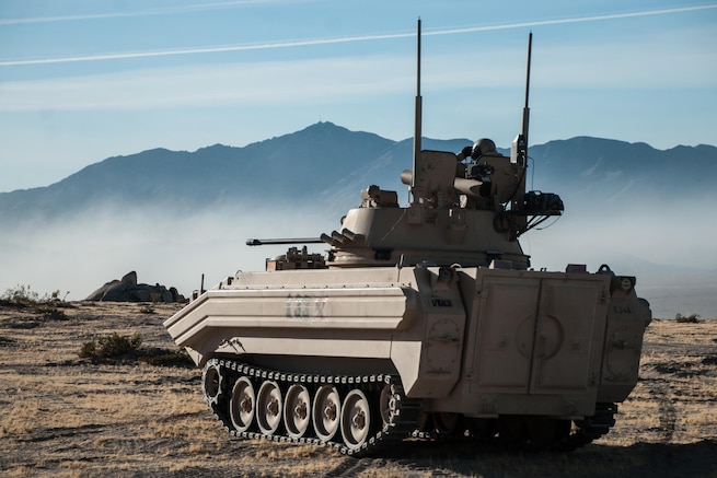 A soldier in an opposing-forces surrogate vehicle surveys the battlefield during a rotation at the National Training Center at Fort Irwin, Calif., Oct. 7, 2016. The soldier is assigned to 1st Squadron, 11th Armored Cavalry Regiment. The rotation focused on the brigade's ability to conduct a deliberate defense of an area during conventional and hybrid threats. Army photo by Sgt. David Edge