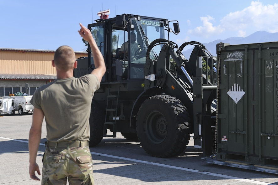 Members of Joint Task Force-Bravo stage equipment at Soto Cano Air Base, Honduras, Oct. 6, 2016, prior to loading onto an aircraft headed to Haiti to support the ongoing Hurricane Matthew disaster relief efforts. Approximately 200 Soldiers, Airmen and Marines from Special Purpose Marine Air-Ground Task Force-Southern Command and Joint Task Force-Bravo deployed this week with two CH-53E Super Stallion, three CH-47 Chinook, and two UH-60L and two HH-60L Black Hawk helicopters to provide heavy and medium lift to support the U.S. Agency for International Development-led mission.