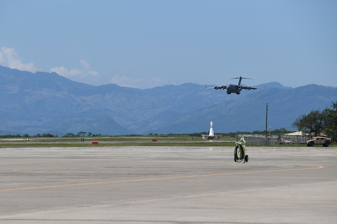 A C-17 Globemaster III from Dover Air Force Base, Del., prepares to land at Soto Cano Air Base, Honduras, Oct. 6, 2016, prior to deploying to Haiti to support the ongoing Hurricane Matthew disaster relief efforts. The aircraft and crew from Dover Air Force Base, Delaware, deployed to Soto Cano within hours of being requested by U.S. Southern Command to transport additional personnel and equipment necessary to sustain flight and maintenance operations for to support Joint Task Force Matthew hurricane relief operations where approximately 200 Soldiers, Airmen and Marines from Special Purpose Marine Air-Ground Task Force-Southern Command and Joint Task Force-Bravo deployed this week with two CH-53E Super Stallion, three CH-47 Chinook, and two UH-60L and two HH-60L Black Hawk helicopters to provide heavy and medium lift to support the U.S. Agency for International Development-led mission.