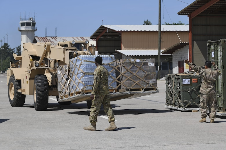 Members of Joint Task Force-Bravo stage supplies at Soto Cano Air Base, Honduras, Oct. 6, 2016, prior to loading onto an aircraft headed to Haiti to support the ongoing Hurricane Matthew disaster relief efforts. As nine helicopters assigned to Special Purpose Marine Air-Ground Task Force-Southern Command and JTF-Bravo deployed Oct. 4 and 5 with personnel and supplies, multiple mobility aircraft followed picking up pallets from Soto Cano AB to sustain Hurricane Matthew disaster relief operations in Haiti.