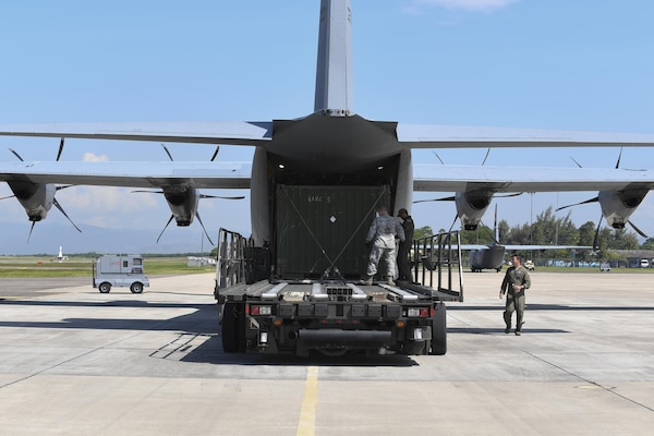 "U.S. Air Force Staff Sgt. Dustin Jett, 612th Air Base Squadron senior information controller, helps aircrew members from Dyess Air Force Base, Texas load a ""conex"" box onto a C-130J Hercules at Soto Cano Air Base, Honduras, Oct. 7, 2016. U.S. Southern Command requested heavy airlift to transport critical equipment packages needed to sustain helicopter flight operations in Haiti being conducted by Special Purpose Marine Air-Ground Task Force-Southern Command and Joint Task Force-Bravo's 1st Battalion, 228th Aviation Regiment using two CH-53E Super Stallions, three CH-47 Chinooks, and two UH-60L and two HH-60L Black Hawks in support of the U.S. Agency for International Development-led mission to alleviate human suffering and bolster Haitian disaster response capabilities."