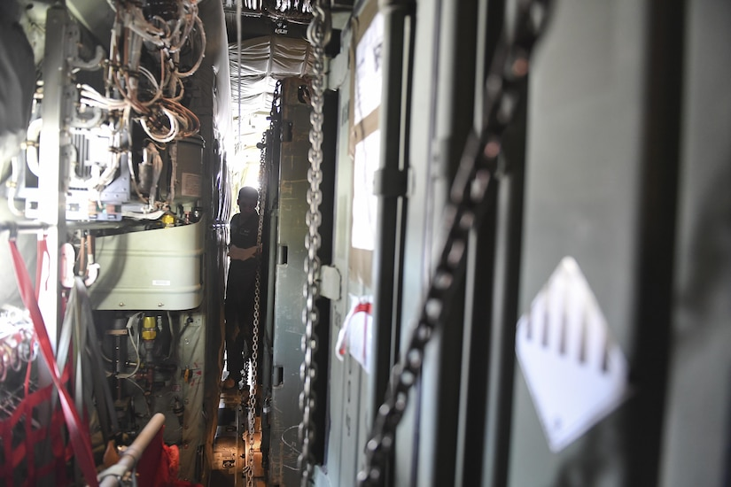 An aircrew member from Dyess Air Force Base, Texas takes inventory of cargo onboard a C-130J Hercules at Soto Cano Air Base, Honduras, Oct. 7, 2016, that was headed to Haiti to provide needed sustainment equipment for use by Joint Task Force Matthew. Extensive joint planning between Special Purpose Marine Air-Ground Task Force-Southern Command and Joint Task Force-Bravo logistics personnel was required to establish load plans and cargo prioritization so the equipment would be ready to load and transport without delay to prevent any mission stoppages or shortfalls.