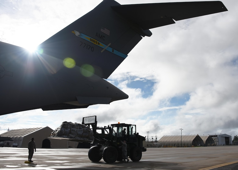 Logistics crews from the 612th Air Base Squadron load a C-17 Globemaster III cargo aircraft at Soto Cano Air Base, Honduras, with equipment destined for Port-au-Prince, Haiti to support Joint Task Force Matthew hurricane relief operations, Oct. 8, 2016. This C-17 was one of two aircraft rapidly deployed to Soto Cano to provide airlift for sustainment supplies and additional JTF-Bravo and Special Purpose Marine Air-Ground Task Force-Southern Command personnel who are conducting disaster relief efforts as part of JTF-Matthew using two CH-53E Super Stallion, three CH-47 Chinook, and two UH-60L and two HH-60L Black Hawk helicopters. (U.S. Air Force photo by Capt. David Liapis)