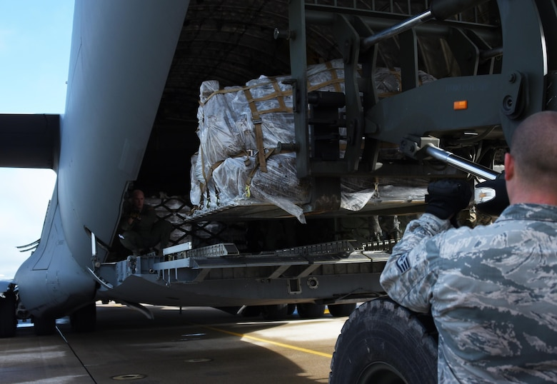 U.S. Air Force Staff Sgt. Dustin Jett, 612th Air Base Squadron senior information controller, halts a forklift as it loads equipment into a C-17 Globemaster cargo aircraft destined for Port-au-Prince, Haiti to support Joint Task Force Matthew hurricane relief operations, Oct. 8, 2016 at Soto Cano Air Base, Honduras. Approximately 200 Soldiers, Airmen and Marines from Special Purpose Marine Air-Ground Task Force-Southern Command and Joint Task Force-Bravo deployed this week with two CH-53E Super Stallion, three CH-47 Chinook, and two UH-60L and two HH-60L Black Hawk helicopters to provide heavy and medium lift to support the U.S. Agency for International Development-led mission. (U.S. Air Force photo by Capt. David Liapis)