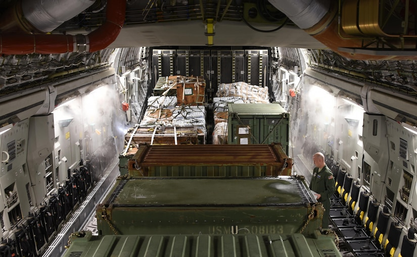 U.S. Air Force Staff Sgt. Daniel Matthews, 3rd Airlift Squadron loadmaster, inspects cargo that was loaded on a C-17 Globemaster III cargo aircraft at Soto Cano Air Base, Honduras, before taking off for Port-au-Prince, Haiti where the equipment will be used to support Joint Task Force Matthew hurricane relief operations, Oct. 8, 2016. U.S. Southern Command requested heavy airlift to transport critical equipment packages needed to sustain helicopter flight operations in Haiti being conducted by Special Purpose Marine Air-Ground Task Force-Southern Command and Joint Task Force-Bravo's 1st Battalion, 228th Aviation Regiment using two CH-53E Super Stallions, three CH-47 Chinooks, and two UH-60L and two HH-60L Black Hawks in support of the U.S. Agency for International Development-led mission to alleviate human suffering and bolster Haitian disaster response capabilities. (U.S. Air Force photo by Capt. David Liapis)