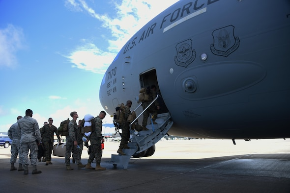 U.S. Marines with the Special Purpose Marine Air-Ground Task Force-Southern Command board a C-17 Globemaster III cargo aircraft at Soto Cano Air Base, Honduras, Oct. 8, 2016, for a deployment to Port-au-Prince, Haiti where they will augment approximately 150 other Soldiers, Airmen and Marines from Joint Task Force-Bravo and SPMAGTF-SC who deployed earlier this week with two CH-53E Super Stallion, three CH-47 Chinook, and two UH-60L and two HH-60L Black Hawk helicopters to provide heavy and medium lift to support the U.S. Agency for International Development-led mission. While in Haiti, SPMAGTF-SC and JTF-Bravo personnel are part of Joint Task Force Matthew, a temporary command established by SOUTHCOM in Port-au-Prince, under the command of U.S. Navy Rear Adm. Cedric Pringle, to coordinate and execute the combined Department of Defense supporting elements that include the Marine and Army aircraft from Soto Cano and ships and aircraft from the Navy, Air Force and Coast Guard. (U.S. Air Force photo by Capt. David Liapis)
