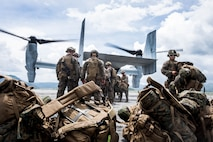 Marines with Echo Company, 2nd Battalion, 4th Marine Regiment, land in Colonel Ernesto Ravina Air Base, Philippines, to begin bilateral training with their counterparts in the Philippine Marine Corps as part of Philippine Amphibious Landing Exercise 33 (PHIBLEX). PHIBLEX is an annual U.S.-Philippine military bilateral exercise that combines amphibious capabilities and live-fire training with humanitarian civic assistance efforts to strengthen interoperability and working relationships. (U.S. Navy photo by Ensign Rob Kunzig/Released)