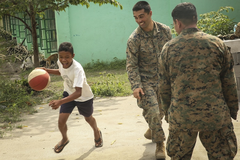 U.S. Marines with Battalion Landing Team, 2nd Battalion, 4th Marine Regiment, 31st Marine Expeditionary Unit, meet, greet and play games with Filipino children during a visit to a local school during Philippines Amphibious Landing Exercise 33 (PHIBLEX) on Col. Ernesto Ravina Air Base, Philippines, October 6, 2016. PHIBLEX is an annual U.S.-Philippine military bilateral exercise which combines amphibious capabilities and live-fire training with humanitarian civic assistance efforts to strengthen interoperability and working relationships. (U.S. Marine Corps photo by Lance Cpl. Jay A. Parks/Released)
