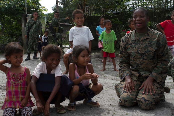 U.S. Marine Lance Cpl. Maresea Potts, a supply clerk with Combat Logistics Battalion 31, 31st Marine Expeditionary Unit, plays a game of Duck-Duck-Goose with Maruglo Elementary School students during a visit to the school on Col. Ernesto Ravina Air Base, Philippines, Oct. 6, 2016. Marines and Sailors with the 31st MEU visited the school to build unity between U.S. forces and the local residents during Philippine Amphibious Landing Exercise 33 (PHIBLEX). PHIBLEX is an annual U.S.-Philippine military bilateral exercise that combines amphibious capabilities and live-fire training with humanitarian civic assistance efforts to strengthen interoperability and working relationships. (U.S. Marine Corps Photo by Staff Sgt. T.T. Parish/Released)