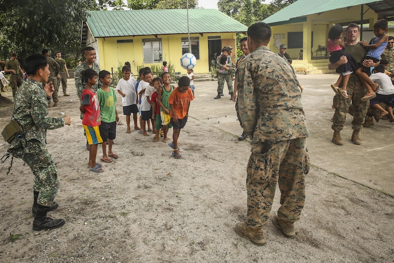 U.S. Marines with Battalion Landing Team, 2nd Battalion, 4th Marine Regiment, 31st Marine Expeditionary Unit, meet, greet and play games with Filipino children during a visit to a local school during Philippine Amphibious Landing Exercise 33 (PHIBLEX) on Col. Ernesto Ravina Air Base, Philippines, October 6, 2016. PHIBLEX is an annual U.S.-Philippine military bilateral exercise which combines amphibious capabilities and live-fire training with humanitarian civic assistance efforts to strengthen interoperability and working relationships. (U.S. Marine Corps photo by Lance Cpl. Jay A. Parks/Released)