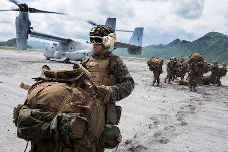 Marines with Echo Company, 2nd Battalion, 4th Marine Regiment, land in Colonel Ernesto Ravina Air Base, Philippines, to begin bilateral training with their counterparts in the Philippine Marine Corps as part of Philippine Amphibious Landing Exercise 33 (PHIBLEX). PHIBLEX is an annual U.S.-Philippine military bilateral exercise that combines amphibious capabilities and live-fire training with humanitarian civic assistance efforts to strengthen interoperability and working relationships.(U.S. Navy photo by Ensign Rob Kunzig/Released)