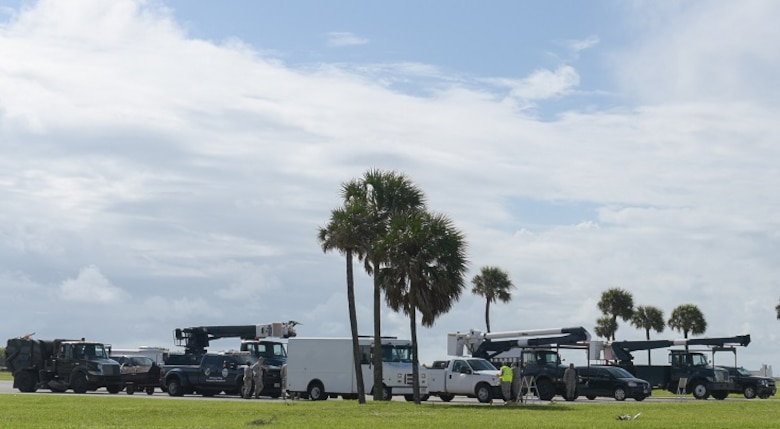 """The Patrick Air Force Base hurricane recovery team prepares to leave the installation and set up operations in an alternate location Oct. 5, 2016. Cape Canaveral Air Force Station also has a hurricane recovery team. The teams are comprised of security forces, civil engineers, medical personnel and other specialties who can assess storm damages and provide subject matter expert recommendations immediately following the storm.  Throughout the time the team is deployed to an alternate location they are in constant contact with the wing's command and control teams, """"Silver Team"""" at Kennedy Space Center and its back up, """"Blue Team"""" at a secure site in Orlando. Together, the wing teams ran 24-hour operations and monitored the storm track from the day prior to the arrival of Hurricane Matthew through recovery operations. The 45th SW returned to normal operations within three days following the storm.  (U.S. Air Force photo/Matthew Jurgens)"""