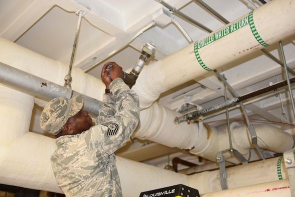 Tech. Sgt. Donrico Hooker, 45th Civil Engineer Squadron, turns a valve on a water chiller pump to bleed air through the Heating, Ventilation and Air Conditioning System in the headquarters building Oct. 8, 2016, at Patrick Air Force Base, Fla.  The 45th Space Wing's hurricane recovery teams, made up of more than 175 personnel have been working around the clock to assess and repair damage on base. The 45th SW returned to normal operations within three days following the storm. (U.S. Air Force photo/Derwin Oviedo)