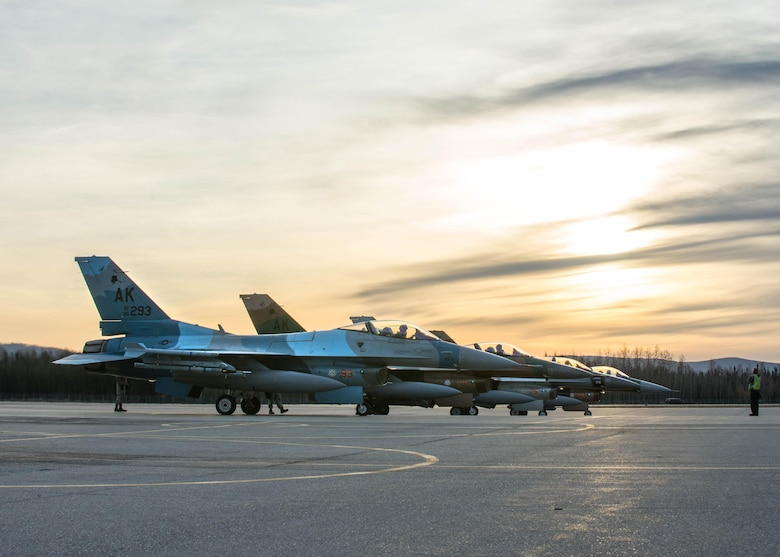 Pilots from the 18th Aggressor Squadron prepare to take off in F-16 Fighting Falcon aircraft after finishing end of runway checks Oct. 10, 2016, during RED FLAG-Alaska 17-1 at Eielson Air Force Base, Alaska. Exercise scenarios occur within the Joint Pacific Alaska Range Complex, a more than 67,000 square mile airspace with minimal impact on the environment. (U.S. Air Force photo by Staff Sgt. Shawn Nickel)