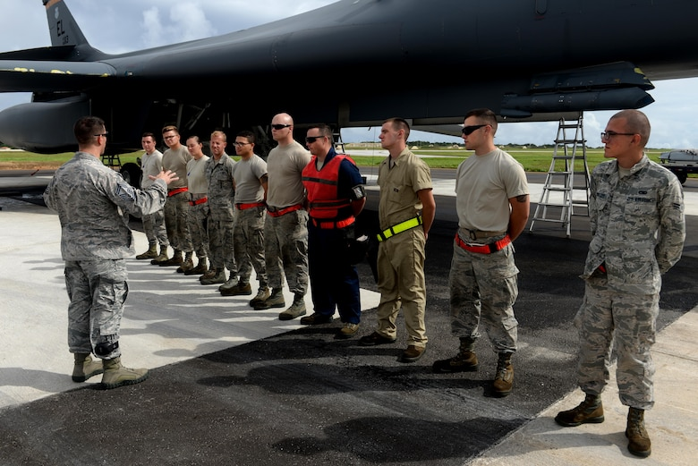 Senior Master Sgt. Christopher Shaver, 36th Wing weapons manager, briefs load crews before a loading exercise Sept. 29, 2016, at Andersen Air Force Base, Guam. LOADEX is a weapons loading exercise where Airmen fine-tune their loading capabilities monthly. The B-1B Lancer aircrews are currently deployed here in support of the Pacific Command's Continuous Bomber Presence mission. (U.S. Air Force photo by Airman 1st Class Alexa Ann Henderson)