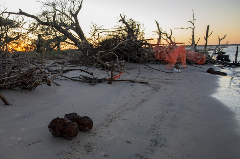 U.S. Air Force Explosive Ordnance Disposal technicians work with local law enforcement bomb squad members to transport Civil War cannonballs washed ashore from  Hurricane Mathew to a safe location at Folly Beach, S.C., Oct. 9, 2016. After the discovery of ordnance on the beach local law enforcement and the Air Force worked together to properly dispose of the hazards.