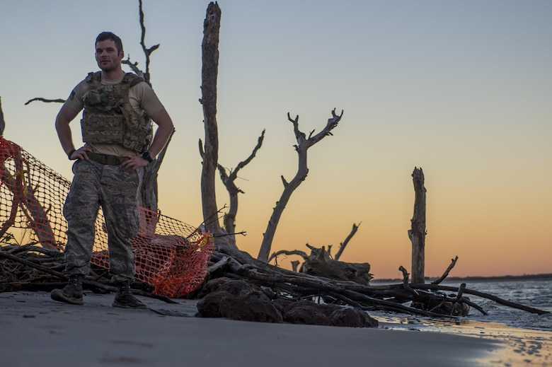 U.S. Air Force Senior Airman Michael Schuffer, an Explosive Ordnance Disposal technician with the 628th Civil Engineer squadron, work with local law enforcement bomb squad members to transport Civil War cannonballs washed ashore from  Hurricane Matthew to a safe location at Folly Beach, S.C., Oct. 9, 2016. After the discovery of ordnance on the beach, local law enforcement and Air Force personnel worked together to properly dispose of the hazards.
