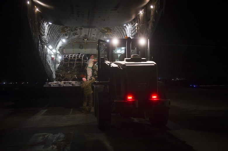 U.S. Air Force C-17 Globemaster III crewmembers load cargo during a transport mission in support of Operation Freedom Sentinel in Southwest Asia Sept. 30, 2016. The C-17 is the newest most flexible cargo aircraft to enter the airlift force. The C-17 is capable of rapid strategic delivery of troops and all types of cargo to main operating bases or directly to forward bases in the deployment area. (U.S. Air Force photo by Staff Sgt. Douglas Ellis/Released)