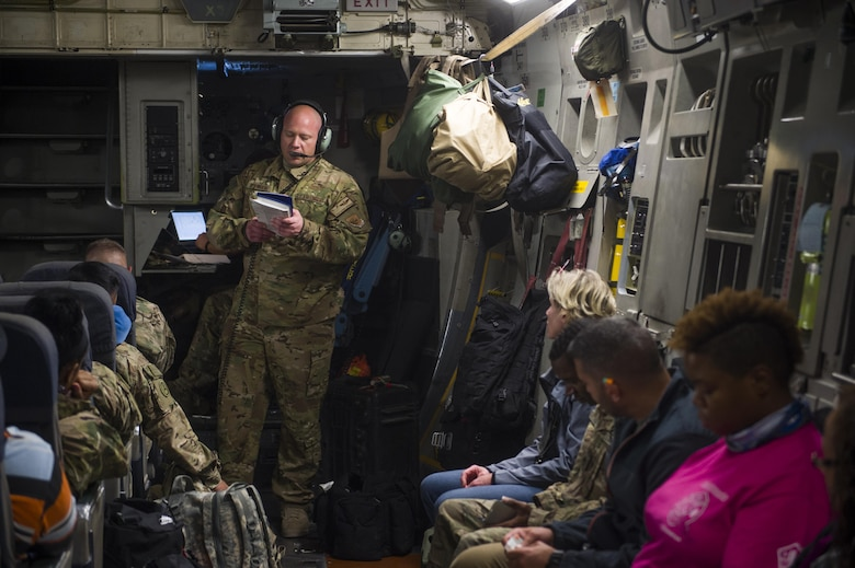 A U.S. Air Force C-17 Globemaster III loadmaster briefs passengers on in-flight emergency procedures during a transport mission in support of Operation Freedom Sentinel in Southwest Asia Sept. 30, 2016. The C-17 is the newest most flexible cargo aircraft to enter the airlift force. The C-17 is capable of rapid strategic delivery of troops and all types of cargo to main operating bases or directly to forward bases in the deployment area. (U.S. Air Force photo by Staff Sgt. Douglas Ellis/Released)