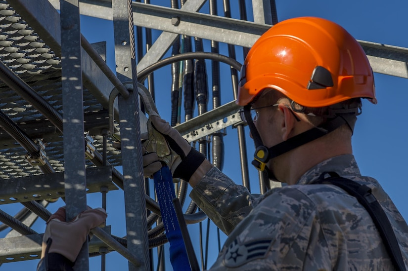 U.S. Air Force Senior Airman Anthony Tressel, radio frequency transmission technician with the 628th Communications Squadron, inspects a ultra high frequency (UHF) antenna for wind damage caused by Hurricane Matthew  on Joint Base Charleston, S.C., Oct. 10, 2016. Joint Base personnel are working diligently to return the Joint Base to full operational status after disaster response coordinators assessed damage and verified a safe operating environment.