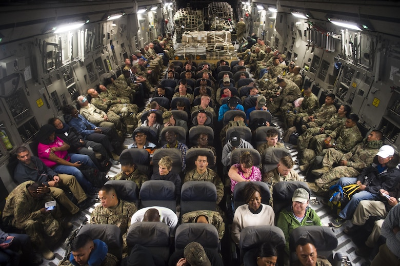 Passengers rest on a C-17 Globemaster III during a transport mission in support of Operation Freedom Sentinel in Southwest Asia Sept. 30, 2016. The C-17 is the newest most flexible cargo aircraft to enter the airlift force. The C-17 is capable of rapid strategic delivery of troops and all types of cargo to main operating bases or directly to forward bases in the deployment area. (U.S. Air Force photo by Staff Sgt. Douglas Ellis/Released)