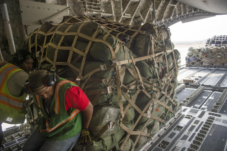 Cargo is offloaded from a C-17 Globemaster III loadmaster during a transport mission in support of Operation Freedom Sentinel in Southwest Asia Sept. 30, 2016. The C-17 is the newest most flexible cargo aircraft to enter the airlift force. The C-17 is capable of rapid strategic delivery of troops and all types of cargo to main operating bases or directly to forward bases in the deployment area. (U.S. Air Force photo by Staff Sgt. Douglas Ellis/Released)