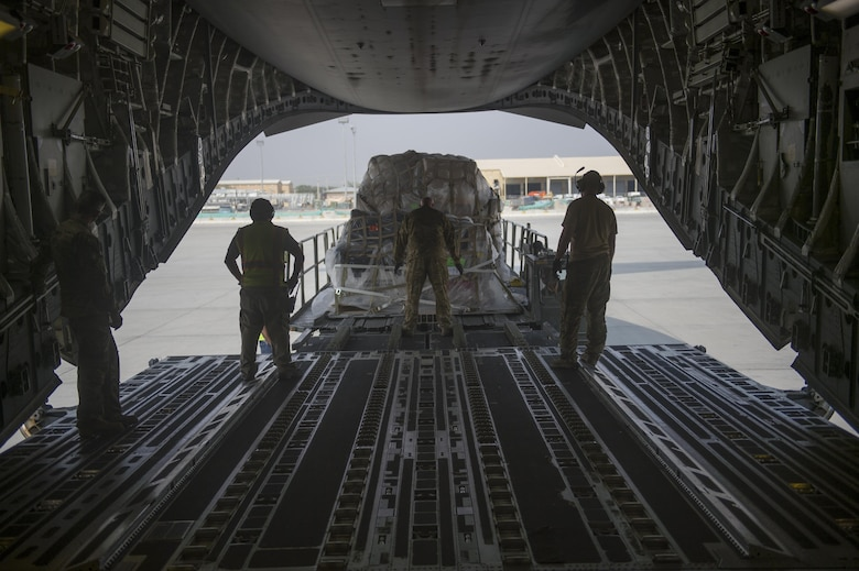 A U.S. Air Force C-17 Globemaster III loadmaster directs a loading truck during a transport mission in support of Operation Freedom Sentinel in Southwest Asia Sept. 30, 2016. The C-17 is the newest most flexible cargo aircraft to enter the airlift force. The C-17 is capable of rapid strategic delivery of troops and all types of cargo to main operating bases or directly to forward bases in the deployment area. (U.S. Air Force photo by Staff Sgt. Douglas Ellis/Released)