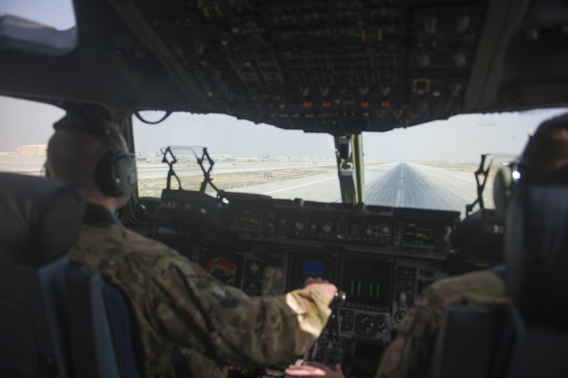U.S. Air Force C-17 Globemaster III pilots prepare to take off during a transport mission in support of Operation Freedom Sentinel in Southwest Asia Sept. 30, 2016. The C-17 is the newest most flexible cargo aircraft to enter the airlift force. The C-17 is capable of rapid strategic delivery of troops and all types of cargo to main operating bases or directly to forward bases in the deployment area. (U.S. Air Force photo by Staff Sgt. Douglas Ellis/Released)