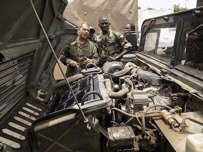 Cpl. Gregory Taylor, a motor transport mechanic with Special Purpose Marine Air-Ground Task Force Crisis Response-Africa, shows the Gendarmerie Nationale Senegalaise how to do maintenance on a High Mobility Multipurpose Wheeled Vehicle (HMMWV) on Aug. 22, 2016, near Dakar, Senegal. On 2 August, 2016, the United States donated 23 HMMWVs to Senegal via the Excess Defense Articles (EDA) program. The HMMWVs will be used to support both Peace Keeping efforts abroad and to counter internal security issues, such as the transport of illicit materials across national borders. Recognizing that developing the skills needed to maintain older HMMWVs is just as important as having the equipment itself, planners from the United States and Senegal jointly developed a training program to pass these skills to Senegalese mechanics. This engagement was the first in a series of planned courses of instruction meant to achieve the goal of developing a cadre of Senegalese HMMWV technicians. (U.S. Marine Corps courtesy photo/released)