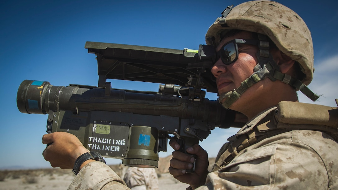 Lance Cpl. Pierre Ponce, low altitude air defense (LAAD) gunner with 2nd LAAD, Battery B, demonstrates the use of a FIM-92 Stinger during a ground based air defense exercise at Site 50, near Wellton, Ariz., Oct. 6, 2016. Weapons and Tactics Instructor course 1-17 is a seven week training event hosted by Marine Aviation Weapons and Tactics Squadron One (MAWTS-1) cadre which emphasizes operational integration of the six functions of Marine Corps aviation in support of a Marine Air Ground Task Force. MAWTS-1 provides standardized advanced tactical training and certification of unit instructor qualifications to support Marine aviation Training and Readiness and assists in developing and employing aviation weapons and tactics.