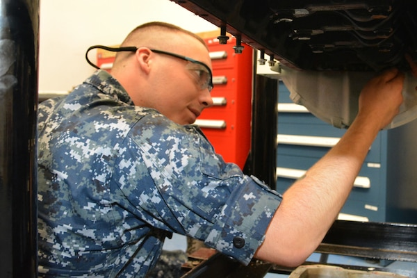 Seaman Jacob Pruett reaches into the cylinder of a marine diesel engine to guide the connecting rod and piston down gently. Pruett works in the Diesel Shop at Southeast Regional Maintenance Center (SERMC). Enginemen operate, maintain and repair internal combustion engines, main propulsion machinery, refrigeration, air conditioning, gas trubine engines and other auxiliary equipment onboard Navy ships.